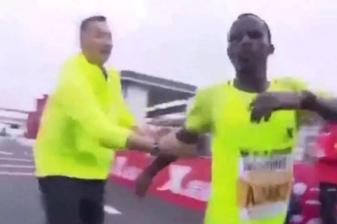 Ethiopian Forced to A Stop at Finish Line! Marathon Drama!